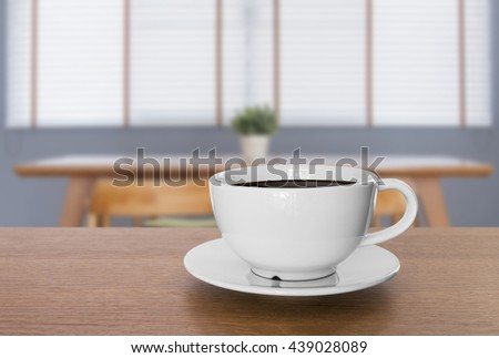 white coffee cup and hot espresso coffee on wooden table. blur background  - stock photo