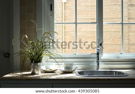 White coffee cup in modern kitchen. - stock photo
