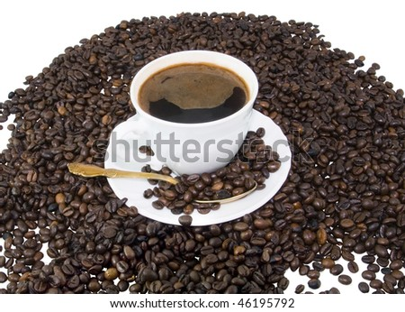 White coffee cup on brown roasted beans - stock photo