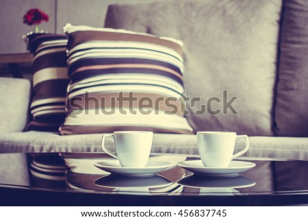White coffee cup on table decoration in living room interior - Vintage Filter