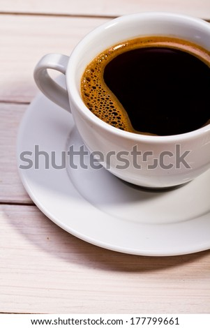 white coffee cup on wooden background  - stock photo