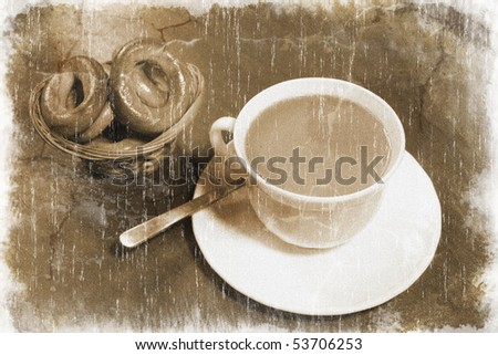 White coffee cup with freshly made coffee and a small woven basket full of bagels (vintage style) - stock photo