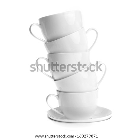 white coffee cups with saucers. Isolated - stock photo