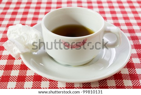 white coffee pair on checkered tablecloth - stock photo