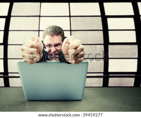 White collar computer criminal in suit wearing handcuffs - stock photo
