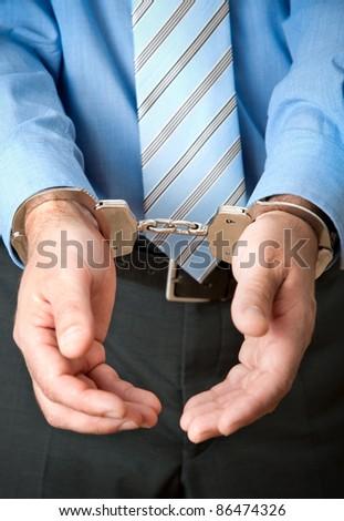 White collar criminal under arrest - stock photo