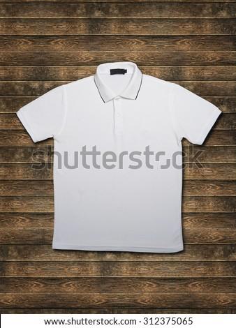 white collar t-shirt on wood background - stock photo