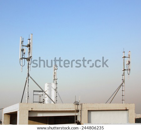 white color antenna repeater tower on blue sky - stock photo