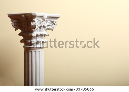 white column indoor on yellow background - stock photo