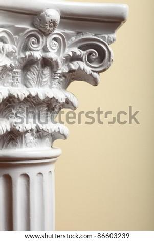 white column indoor on yellow background - stock photo