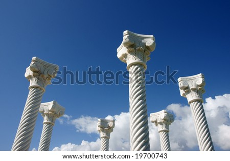 White columns / pillars in blue background of sky - stock photo