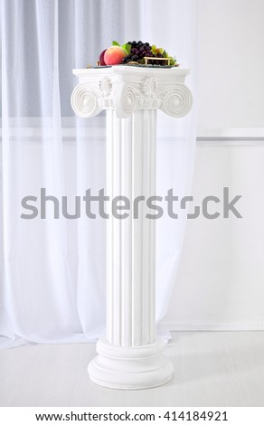White columns with capitals in the style of Renaissance, Baroque. Molding.