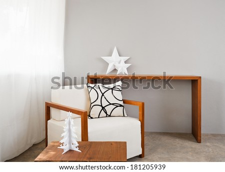 white comfortable sofa seat with interior design items - stock photo