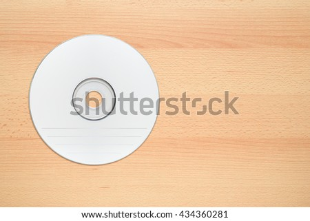 White compact disc on office desk top view - stock photo