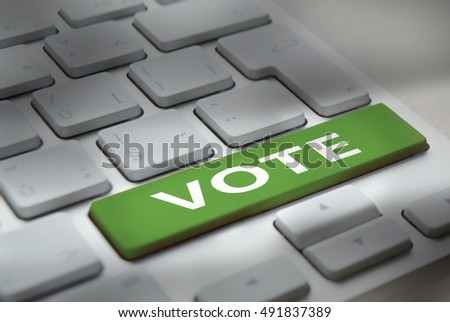 White computer keyboard with 'vote' button