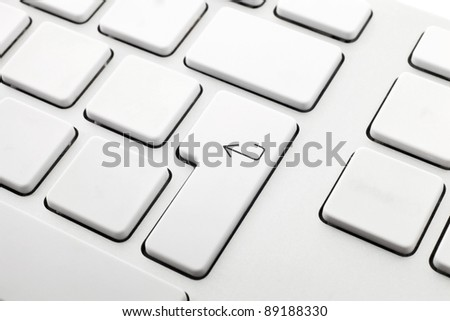 white computer keyboard without letters one with the enter key
