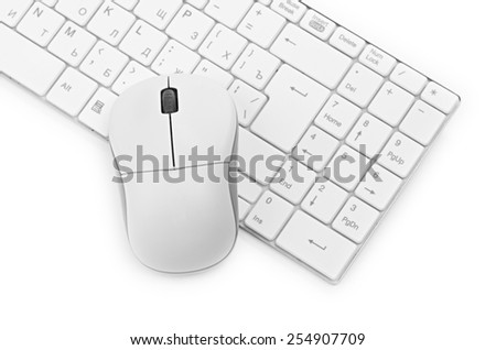 White computer mouse on the keyboard - stock photo