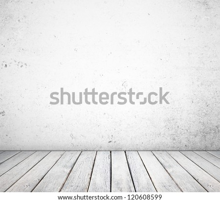 white concrete wall and wood floor