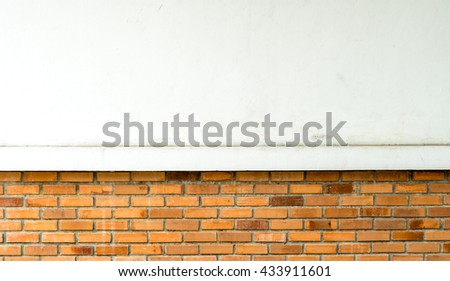White concrete wall with a part of Old brown brick wall