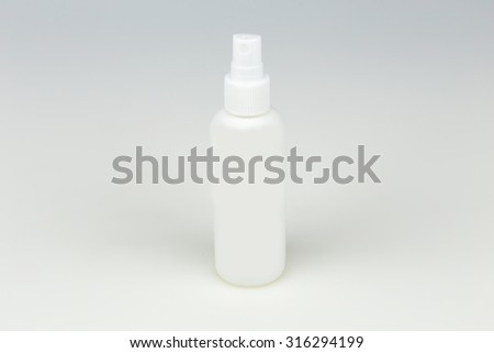 White container of spray bottle - stock photo