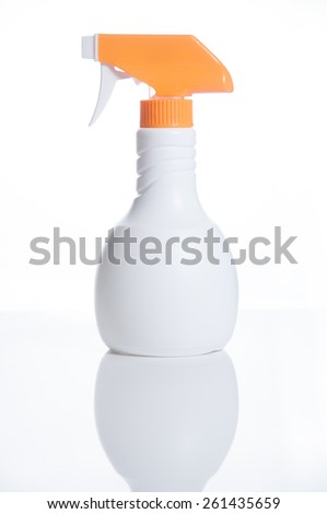 White container with orange head spray bottle isolated over white background. - stock photo