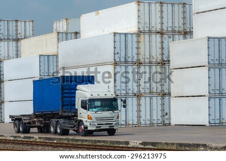 White Containers at the Docks with Truck - stock photo