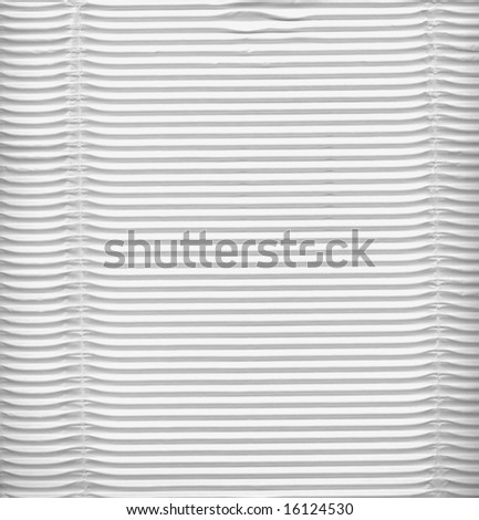 White corrugated cardboard sheet background - stock photo