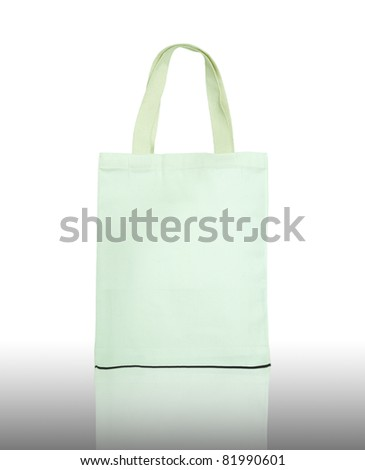 White cotton bag on reflect floor and white background - stock photo