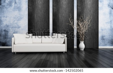 White couch in front of blue and black wall - stock photo