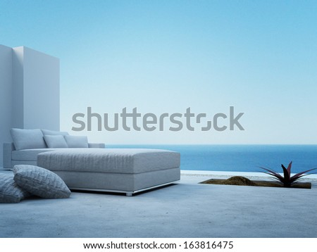 White couch standing on a patio with seascape view - stock photo
