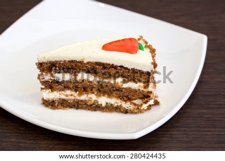 White cream and nuts cake slice on a white plate