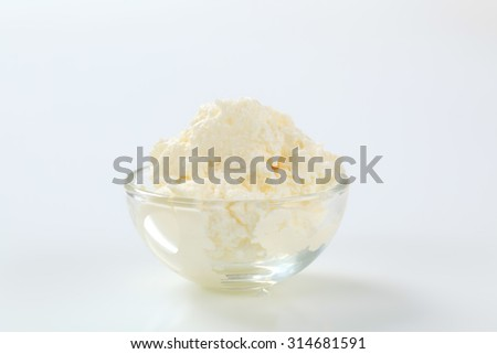 white creamy cheese in a small glass bowl