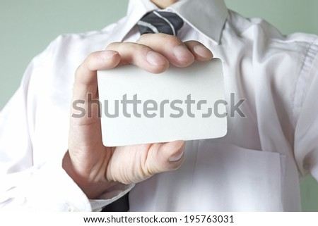 White credit card in the hands of a businessman
