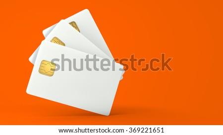 White credit card on orange background - stock photo