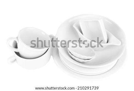 White crockery and kitchen utensils, isolated on white - stock photo