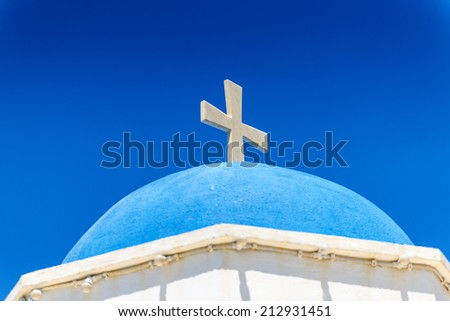 White Cross On A Church In Santorini, Greece - stock photo
