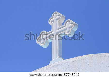 white cross under blue sky