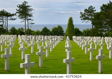 White crosses at the American war cemetery in Normandy. - stock photo