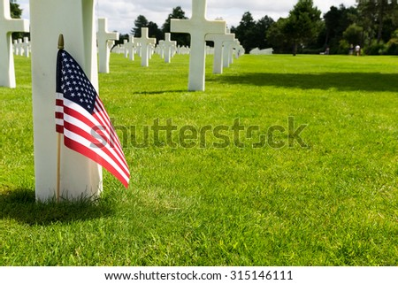 White crosses in American Cemetery, Coleville-sur-Mer, Omaha Beach, Normandy, France - stock photo