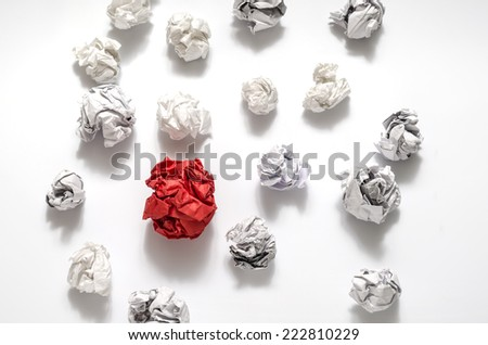 white crumpled paper ball and different red crumpled paper ball on a white background - stock photo