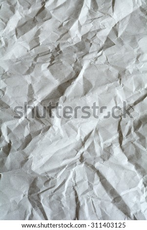 White crumpled paper for background. Brown and yellow textured grunge surface for design.