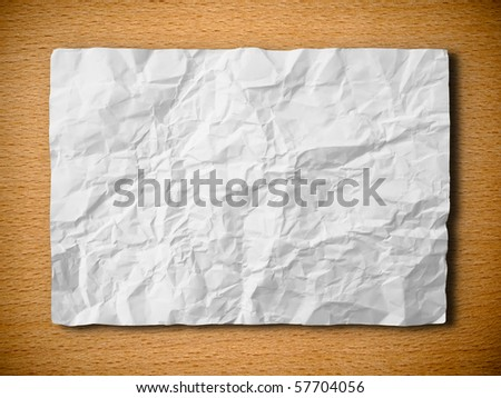 White crumpled paper on beech wood horizontal background