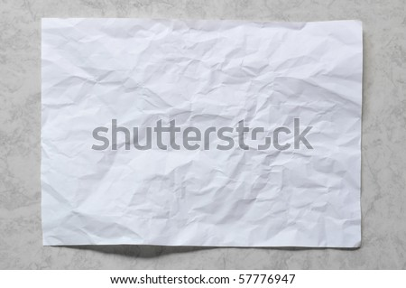 White crumpled paper on black marble background - stock photo