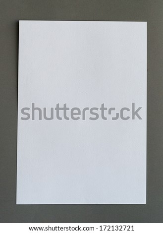 White crumpled paper on gray background vertical
