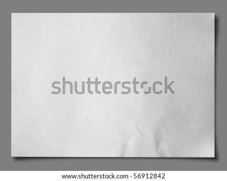 White crumpled paper on gray background with shadow