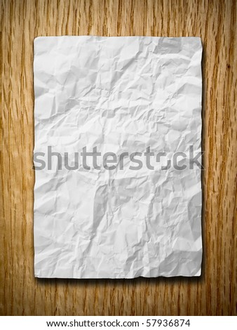 White crumpled paper on red oak wood with shadow