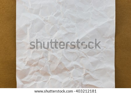 White crumpled paper on wood paper background texture vintage style