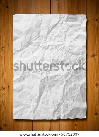 White crumpled paper on wood wall
