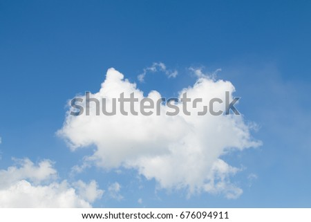 White cumulus clouds on a blue sky