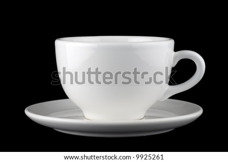 White cup and saucer isolated against black background - stock photo